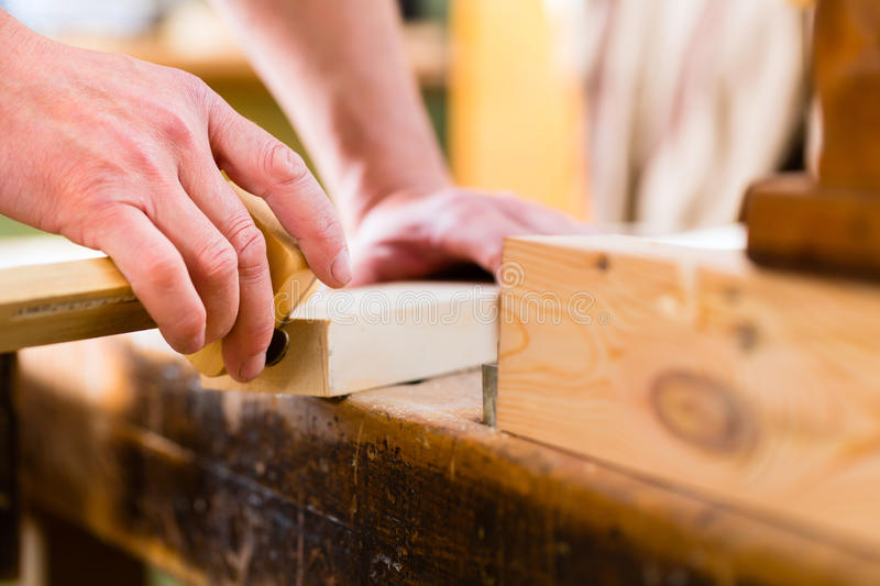 Carpenter with workpiece in carpentry royalty free stock photos