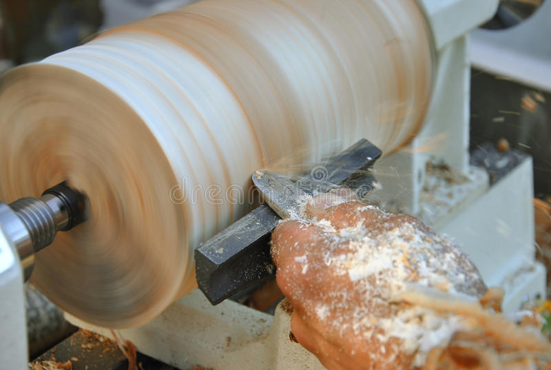 Carpenter works with chisel stock photo
