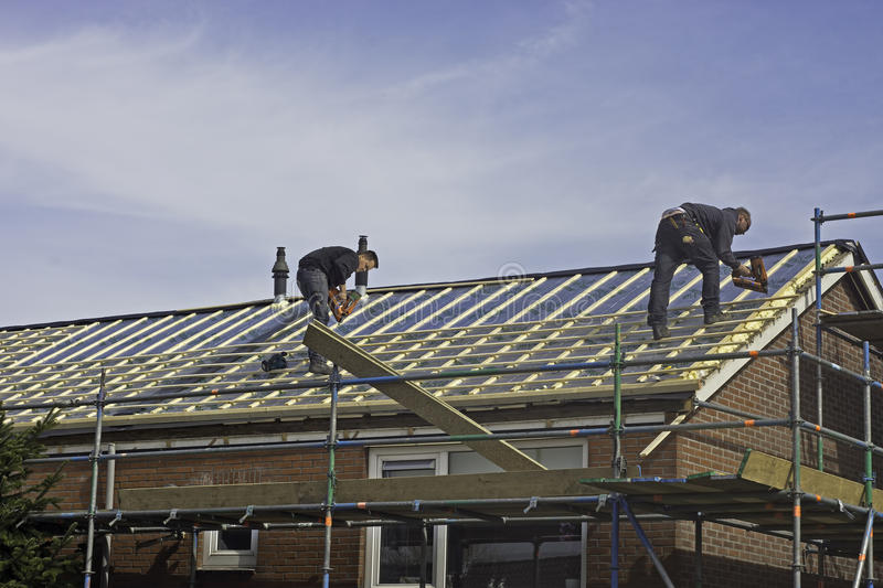 Carpenters applying roof battens stock photo