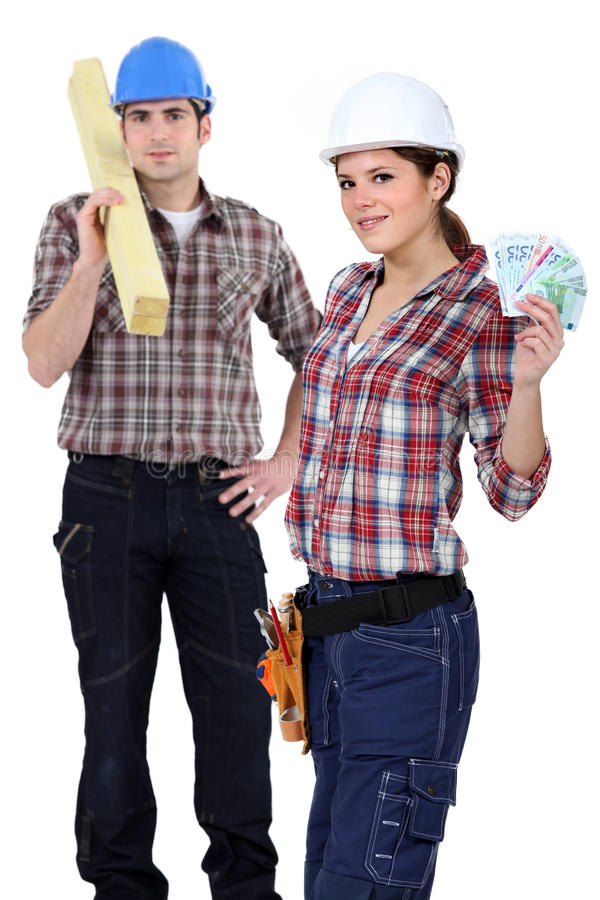 Carpenters with bank notes royalty free stock photography