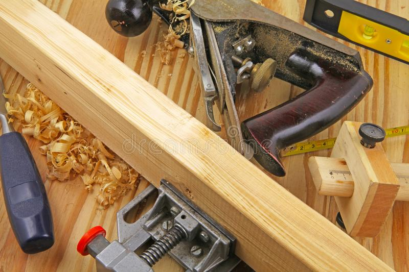 Carpenters bench. A carpenters bench with tools and work piece in vice royalty free stock photo