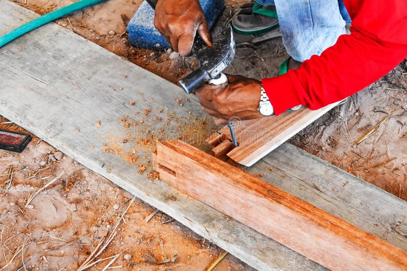 Carpenters are building wooden doors to prepare for home construction. stock photo