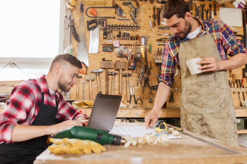 Carpenters with laptop and blueprint at workshop stock image image download carpenters with laptop and blueprint at workshop stock image image of craftsman partner malvernweather Images