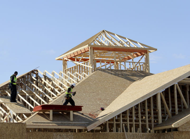 Carpenters on the roof. Carpenters on a roof of a new constructon complex stock photos