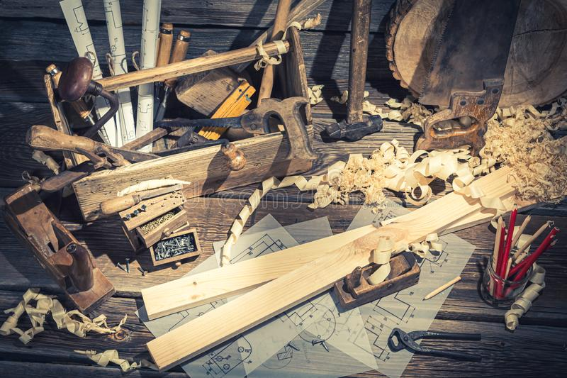 Carpenters table in a workshop on rustic wooden table stock photography