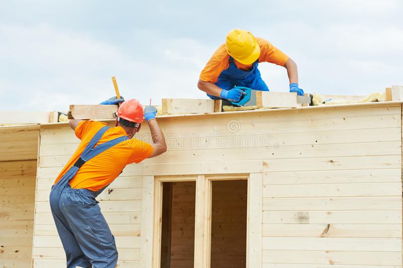 Carpenters at wooden roof work royalty free stock photos