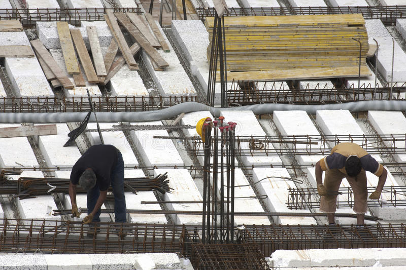 Carpenters at work in construction site preparing reinforcements stock photo