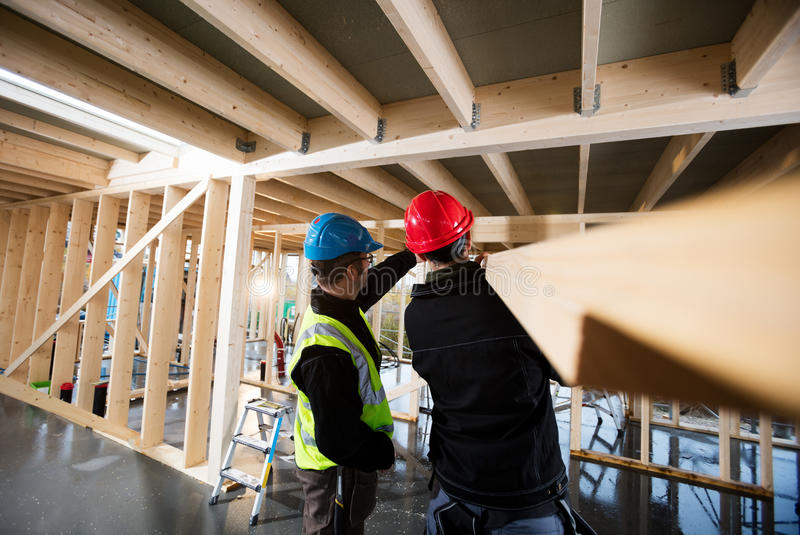 Carpenters Working At Construction Site stock images
