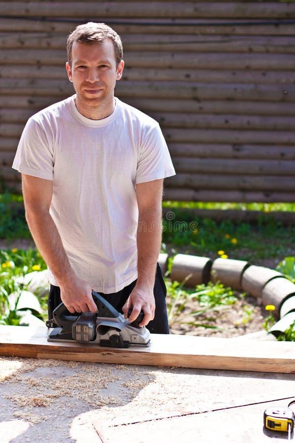 Download Carpentiere Con Gli Aerei Elettrici Immagine Stock - Immagine di carpenteria, domestico: 30826207