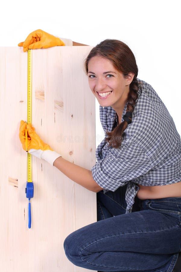 Carpentiere della donna fotografia stock
