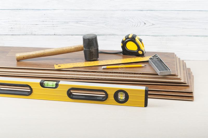 Carpentry concept.Different tools for laying laminate flooring. Copy space for text. stock photos