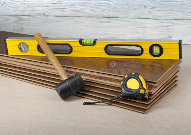 Carpentry concept. Different tools on the new laminate flooring.Copy space for text. royalty free stock photography