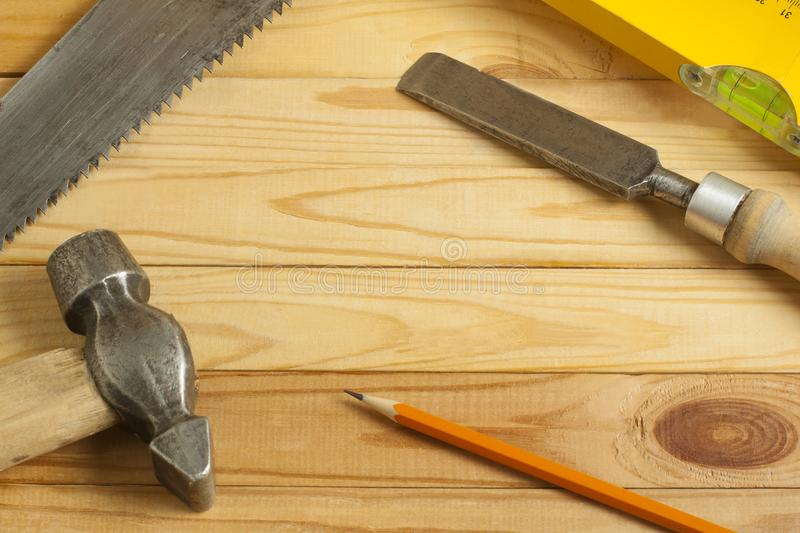 Carpentry concept.Joiner carpenter workplace. Construction tools on wooden table with shavings. Copy space for text. stock images