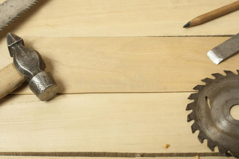 Carpentry concept.Joiner carpenter workplace. Construction tools on wooden table with shavings. Copy space for text. stock photography