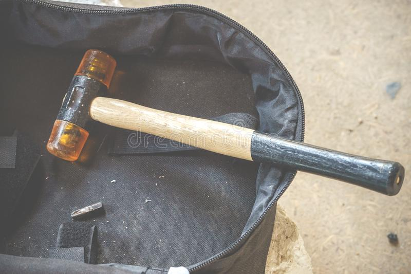 A carpentry hammer with a soft plastic finish to pat a sheet. Double-Face Rubber Hammer with Wood Handle. A carpentry hammer with soft plastic finish to pat a royalty free stock image