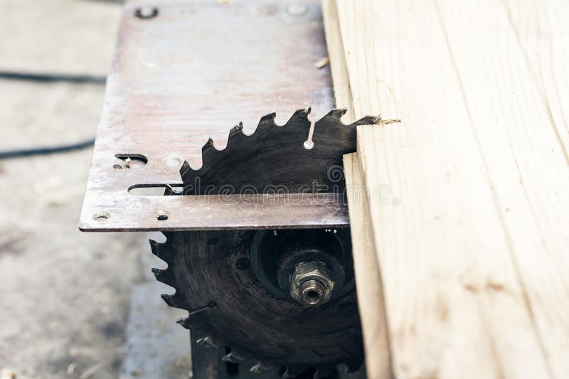 Carpentry machine electronic table saw, sharp cut metal steel silver, retro concept.  stock photo