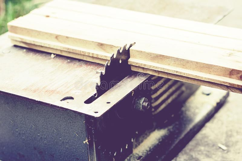 Carpentry machine electronic table saw, sharp cut metal steel silver, retro concept.  stock photos