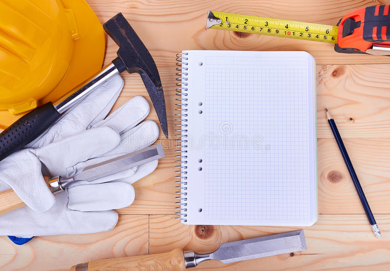 Carpentry tools and a piece of notebook stock image