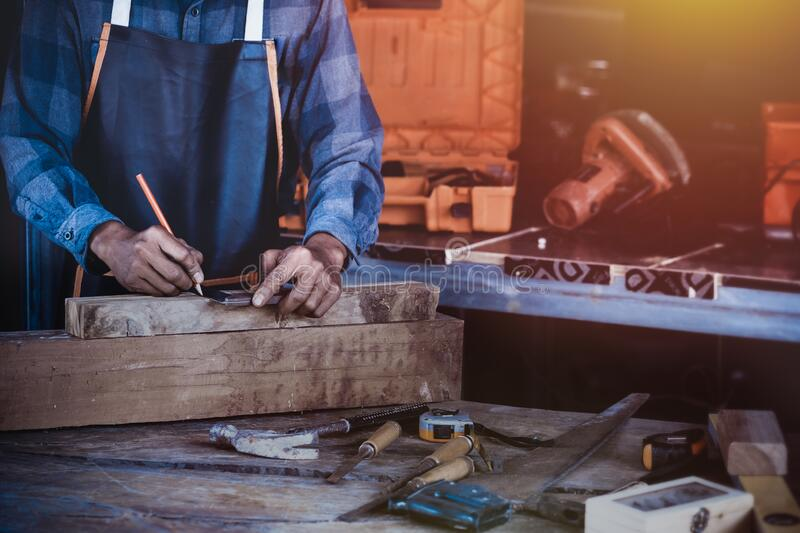 Carpentry works on woodworking machinery in carpentry royalty free stock photos