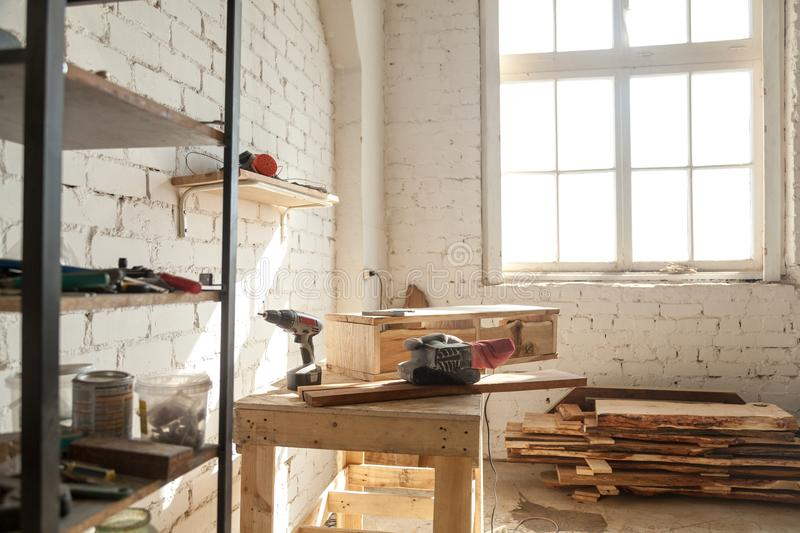 Carpentry workshop interior, joinery shop with tools equipment f. Joinery shop interior with tools and supplies, woodwork machines and equipment, instruments on stock photo