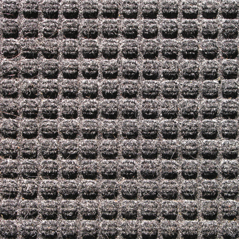 Black square texture. Detailed texture of indoor outdoor black carpeting stock images