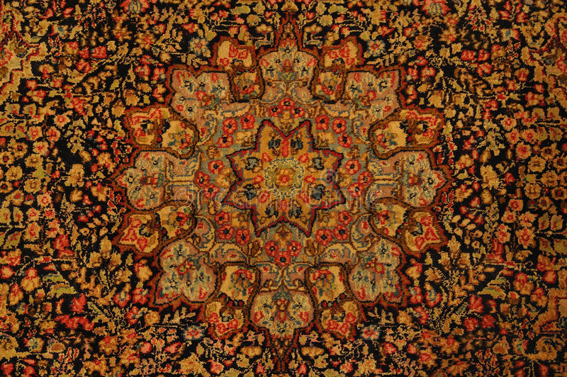 Carpet. An authentic oriental rug is a handmade carpet that is knotted with pile or woven without pile royalty free stock photos