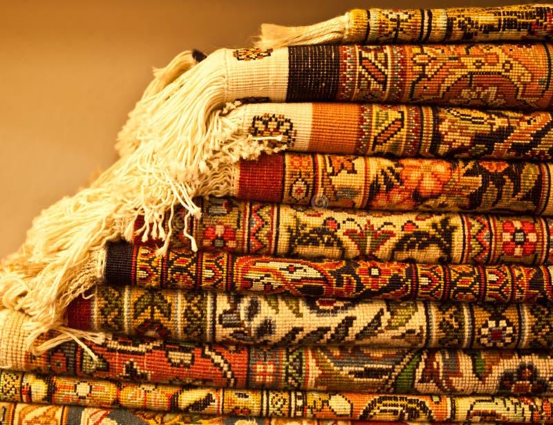 Carpet. Oriental carpet. Persian hand made carpet on shelf of shop stock photo