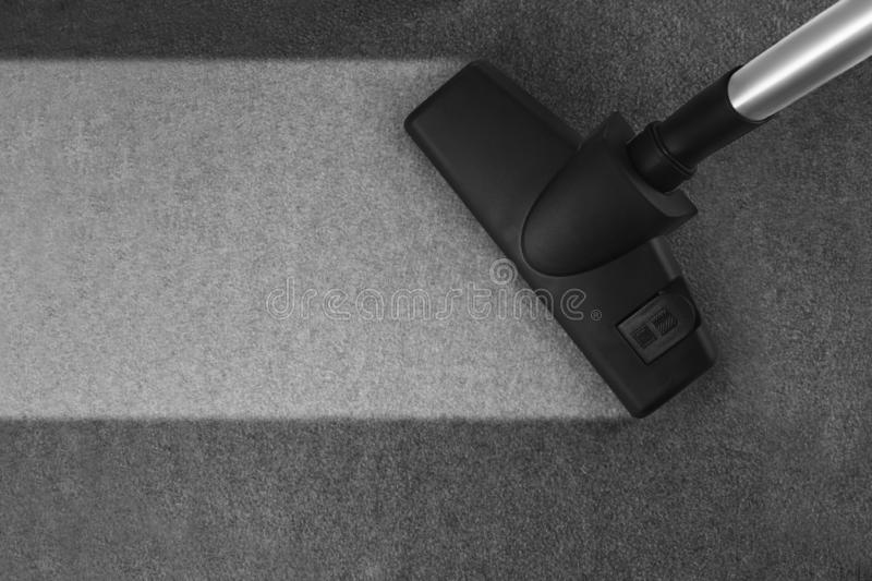 Carpet cleaning with vacuum cleaner and copy space stock photography