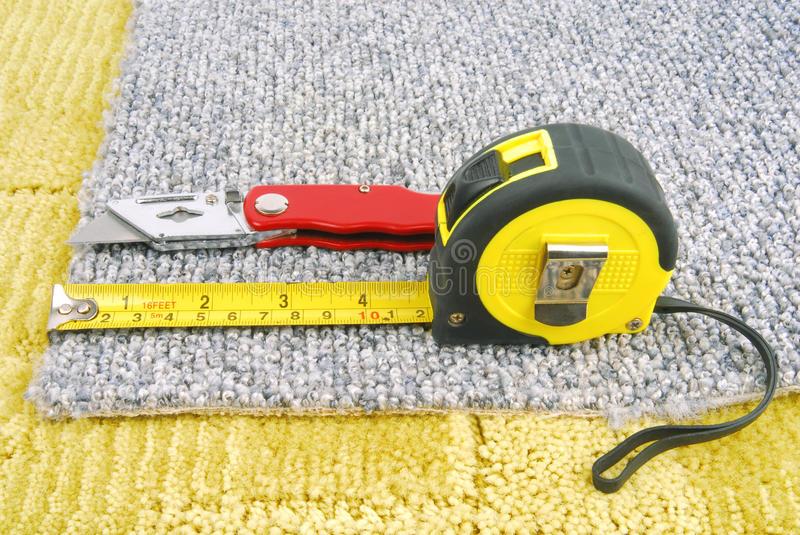 Carpet fitting with tools royalty free stock images
