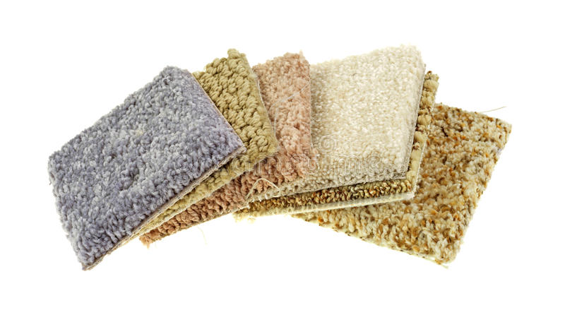 Carpet samples on a white background. Several small squares of carpet samples on a white background stock photos