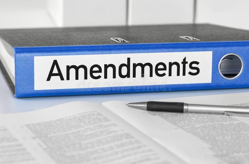 Carpeta azul con las enmiendas de la etiqueta imagen de archivo libre de regalías