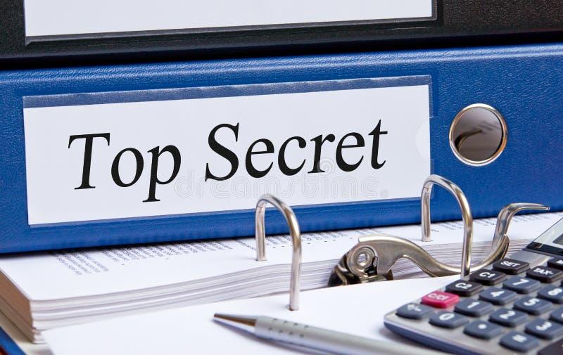 Carpeta de alto secreto en oficina fotos de archivo