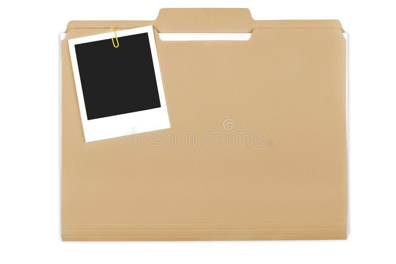 Carpeta de archivos con los documentos y Polaroid en blanco fotografía de archivo