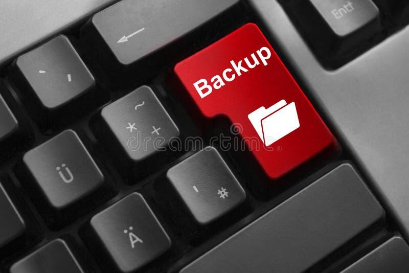 Carpeta de la copia de seguridad del botón rojo del teclado foto de archivo