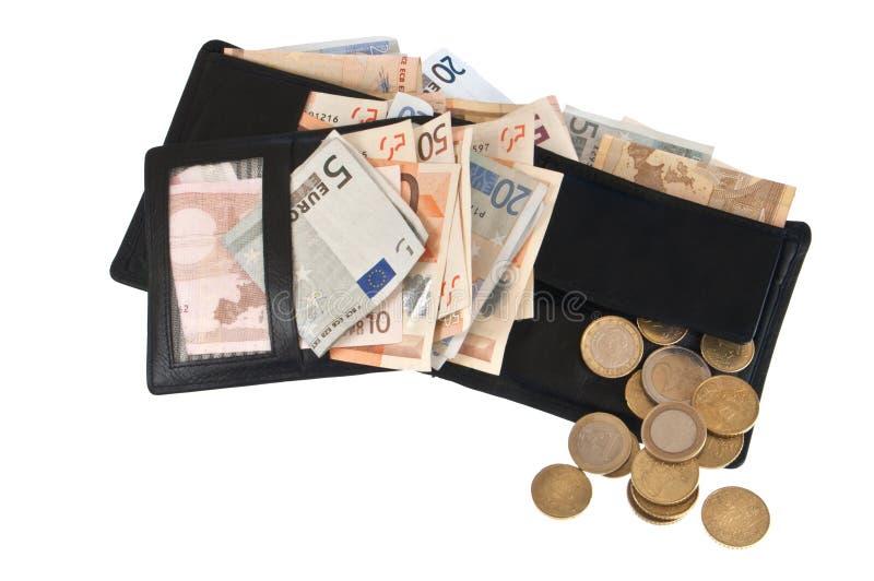 Carpeta llena con las cuentas y las monedas imágenes de archivo libres de regalías