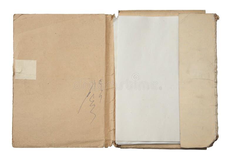 Carpeta vieja con la pila de papeles fotos de archivo