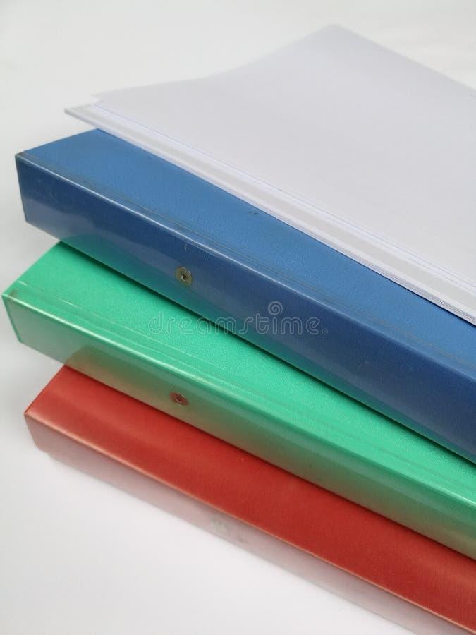 Carpetas coloridas fotos de archivo
