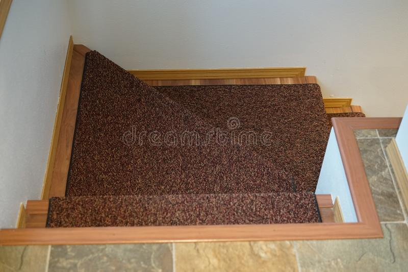 Carpeted steps with wood trim royalty free stock photos