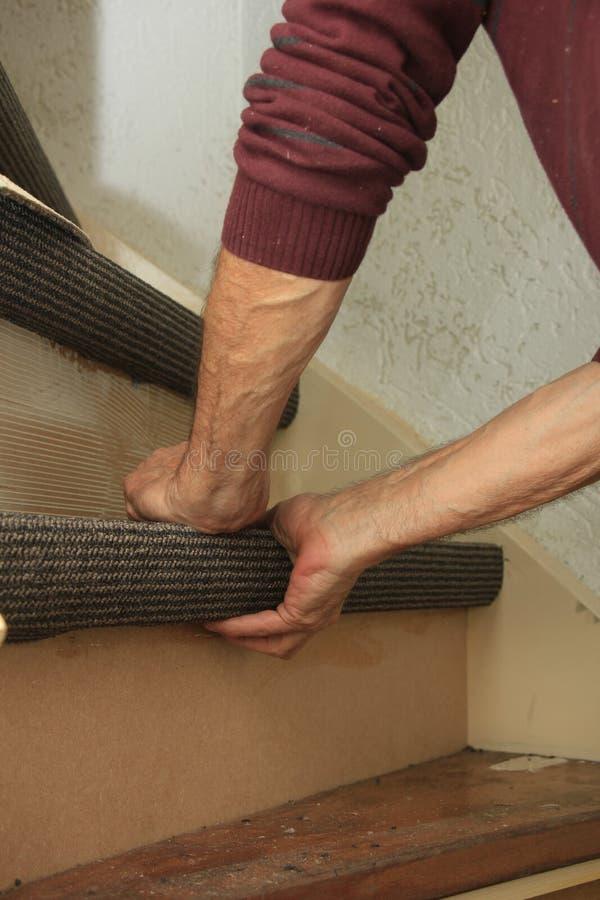 Carpeting a staircase stock photos