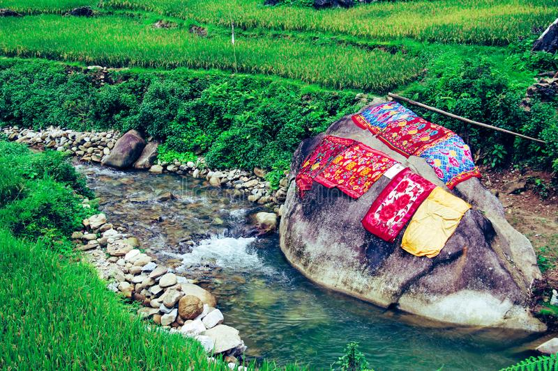 Carpets drying on a big rock of a river. Hand washing, traditional method stock photo