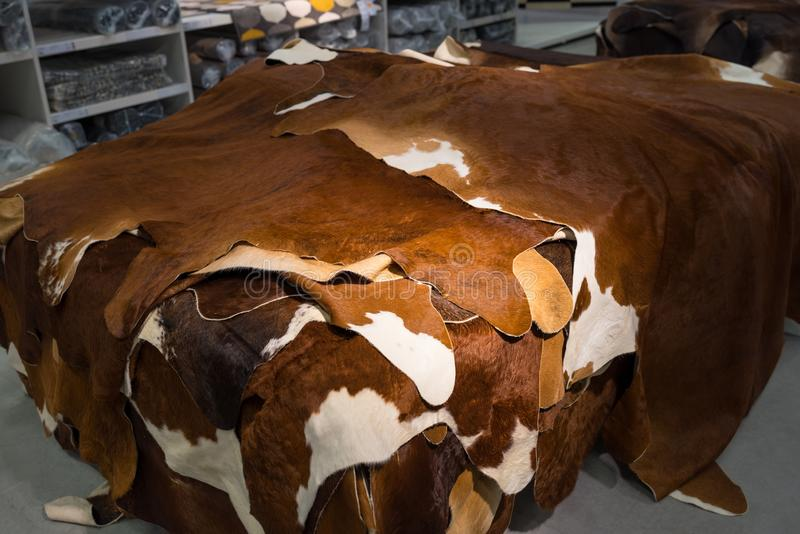 Carpets made out of natural cow leather for sale at a department store royalty free stock images