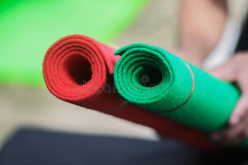 Carpets rolled up in shop store. Object for pet or interiors at home stock photography