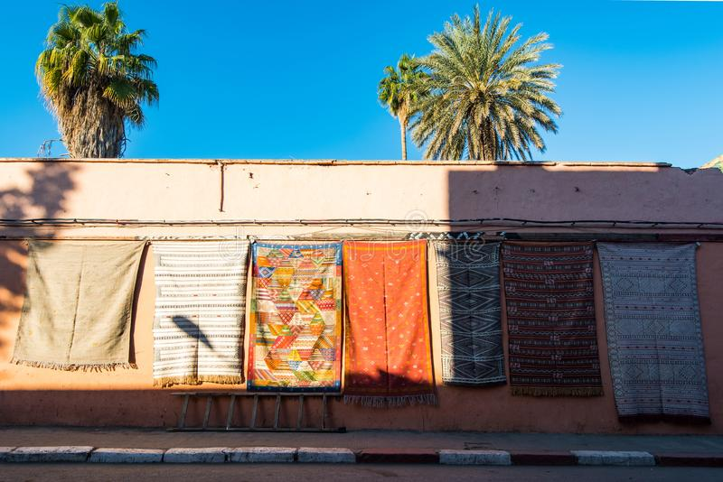 Carpets for sale on the wall in Morocco royalty free stock image