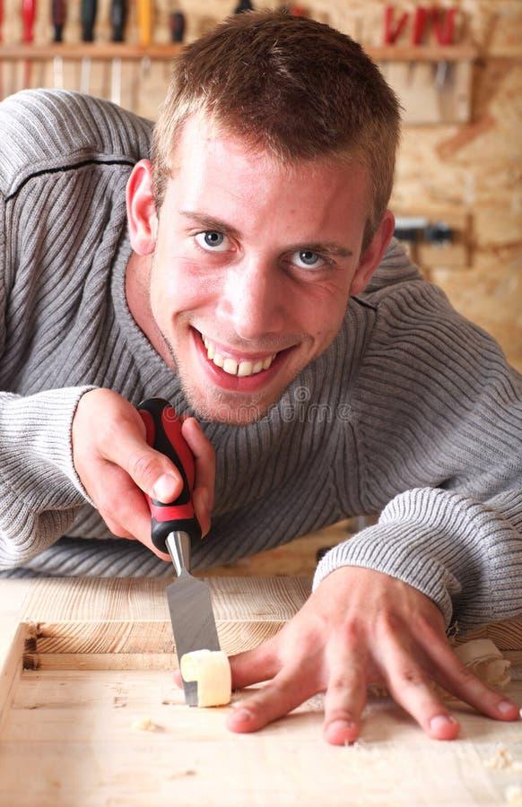 Carpinteiro de sorriso novo imagens de stock