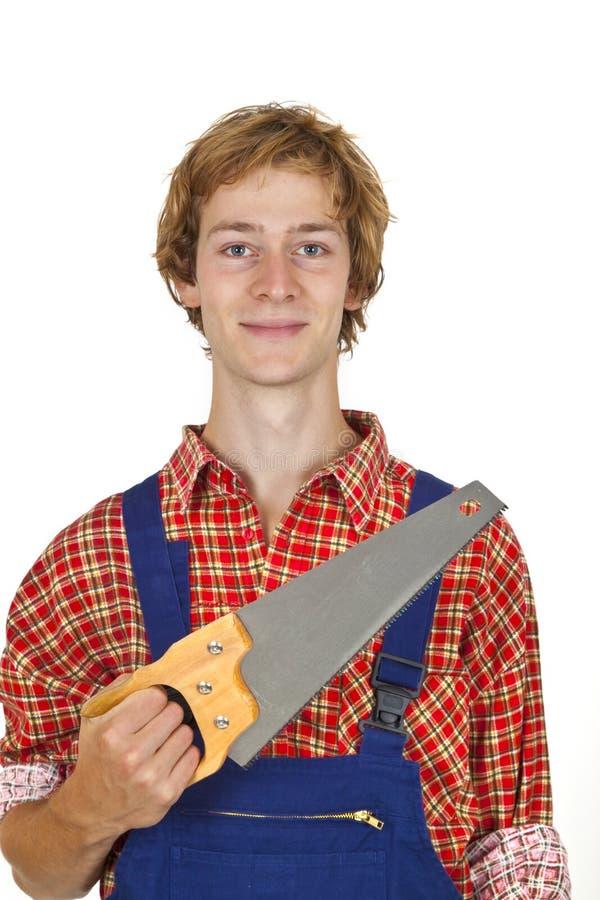 Carpintero con el handsaw fotos de archivo libres de regalías
