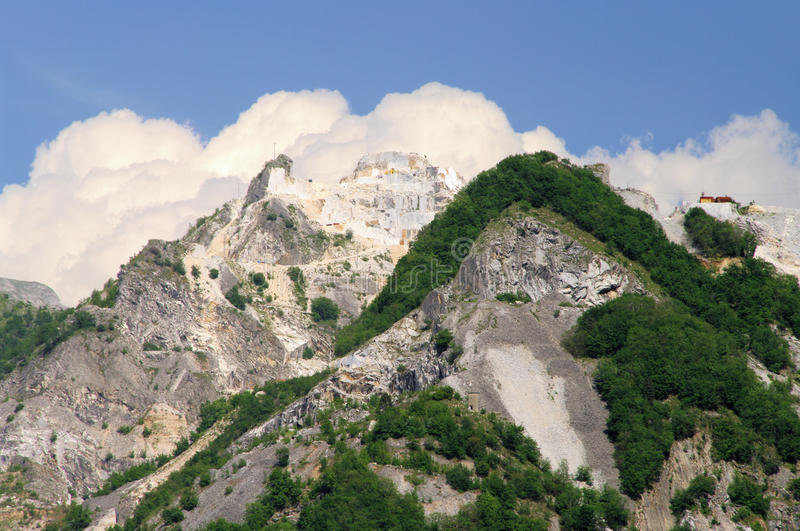Carrara marble stone pit. Carrara, marble stone pit in Italy royalty free stock photography