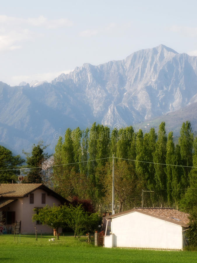 Carrara mountains with farm scene foreground royalty free stock photography