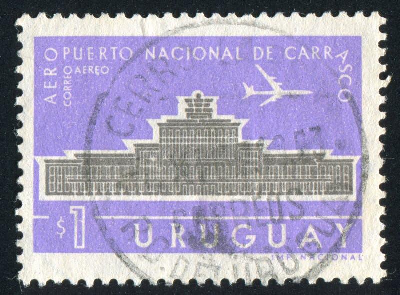 Carrasco National Airport. URUGUAY - CIRCA 1961: stamp printed by Uruguay, shows Carrasco National Airport, circa 1961 stock images