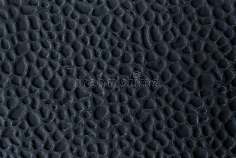 Carreau de céramique avec de relief dans le noir Fond initial abstrait images stock