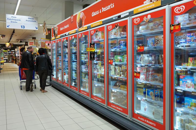 Carrefour Hypermarket interior. MALMEDY, BELGIUM - MAY 2016: Freezer department with Ice cream of Unilever Heartbrand in a Carrefour Hypermarket royalty free stock photography